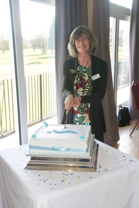 President Diane cutting the celebratory cake